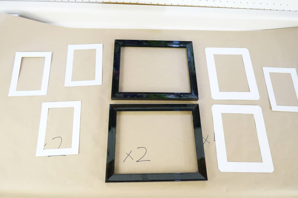 first i hung the four larger frames using double sided adhesive strips from dollarama